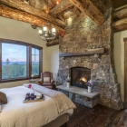 luxury mountain home master bedroom fireplace