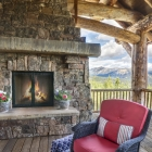 luxury mountain home exterior deck fireplace close up
